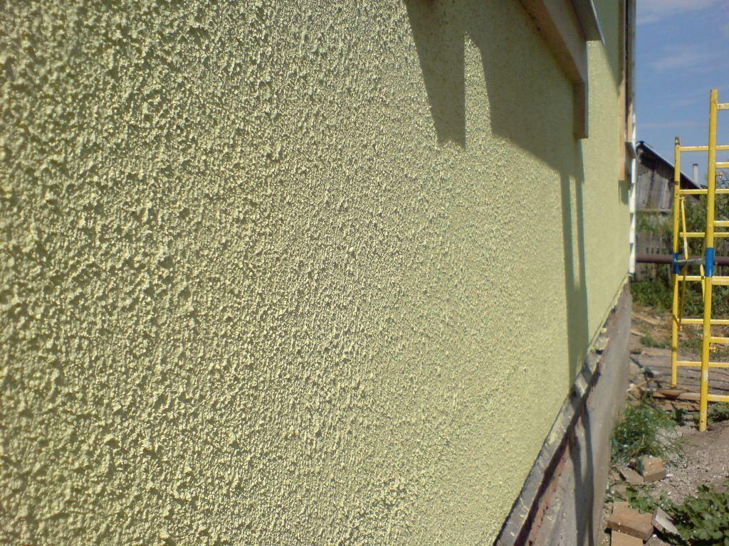Фасад дома из фактурной штукатурки